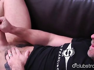He holds his balls while stroking his big hard cock