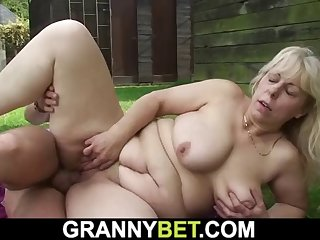 big-cocked guy fucks busty grandma in changing room