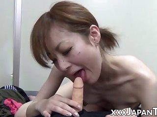 skinny japanese babe rides and sucks a small dildo in pov